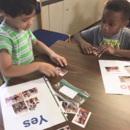 Two Kindergarten boys working on a sorting activity in library class