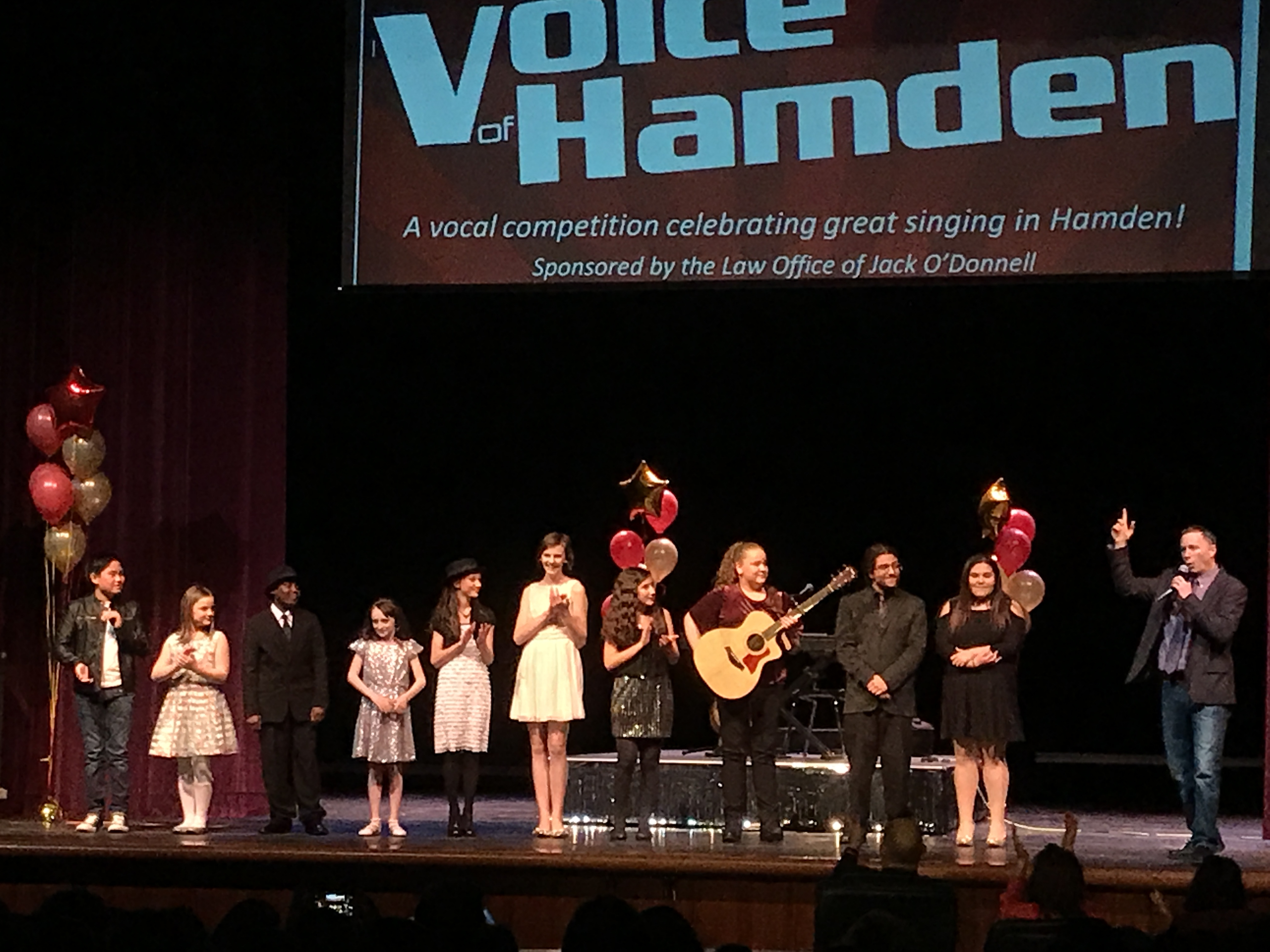 performers on stage at the Voice of Hamden